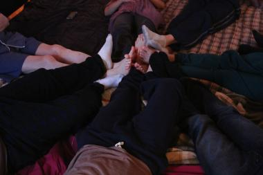 Cuddle partiers enjoying a closing circle cuddle.