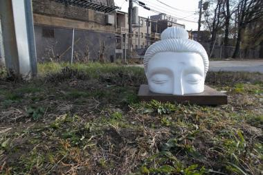 Pictures of various scupltures of an emerging Buddha that have sprouted across Uptown as part of the Ten Thousand Ripples public art project.