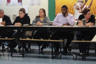 Kilmer Elementary Principal Lawrence White (second from right) listened to parent and teacher testimony at a Nov. 20, 2012, Local School Council meeting.
