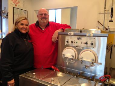 Mardi and Denny Moore, owners of Scooter's Frozen Custard, pose in their shop on Nov. 28, 2012, two days before closing for the winter season. The shop reopens on Friday, March 1.