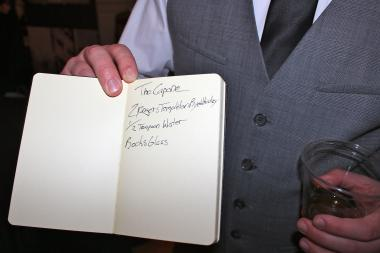 Brandon Phillips, a bartender at the Drawing Room, added Al Capone's drink to his drink book, which Deirdre Capone later signed.