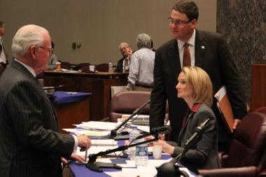 Ald. Edward Burke talks with Chief Financial Officer Lois Scott during a break in Monday's committee meeting.