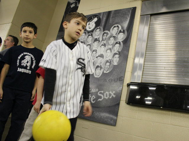 <p>Angelo Ciaravino, 6, a first-grader at St. Jerome, takes his turn bowling at the White Sox holiday party for kids.</p>