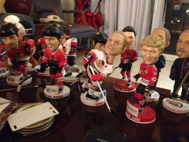 <p>Bob Gertenrich has several Blackhawks bobblehead dolls in his Skokie condominium.</p>