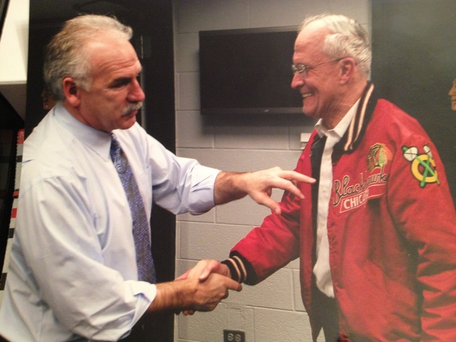<p>Bob Gertenrich shakes hands with Blackhawks coach Joel Quenneville in the team&#39;s locker room.</p>