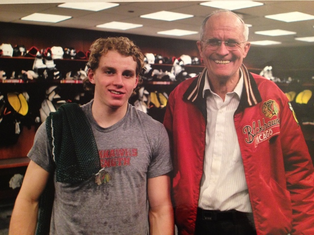 <p>Bob Gertenrich poses with Blackhawks star Patrick Kane in the team&#39;s locker room.</p>