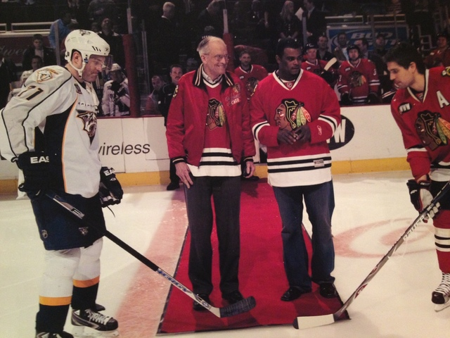 <p>Bob Gertenrich participates in a ceremonial puck drop during a Blackhawks game against the Nashville Predators.</p>