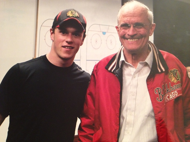 <p>Bob Gertenrich poses with Blackhawks team captain Jonathan Toews in the team&#39;s locker room.</p>
