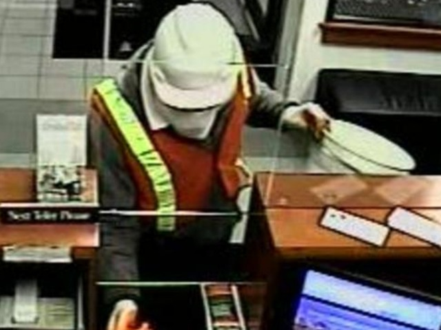 <p>The &quot;Mummy Bandit&quot; is believed to have hit four Chicago banks since December, said an FBI spokeswoman.</p>
