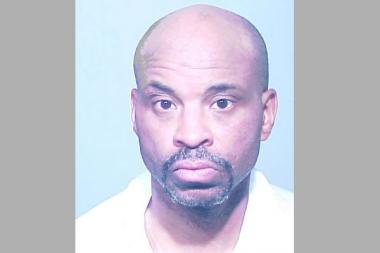 Byron K. Moore, 49, was arrested and charged after allegedly taking a masseuse hostage.
