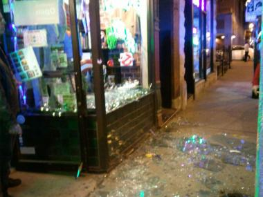 A man landed face-first into Chicago Comic's storefront Saturday during an annual holiday pub crawl. This picture is from the Chicago Comics Facebook page.