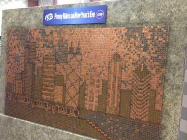 Chicago's skyline rendered in pennies at the Clark/Lake station, part of a MillerCoors and CTA partnership to sponsor one cent rides on public transit during New Year's Eve.