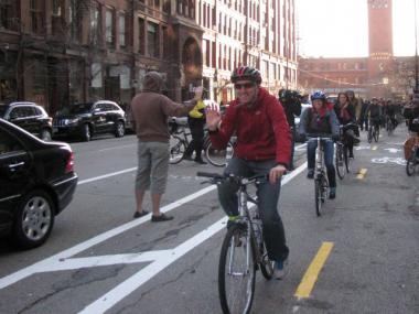 Bike riders test drive the new Dearborn Street protected bike lanes for the first time Friday afternoon.