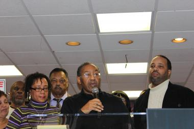 Percy Coleman (c.) is surrounded by family members and the Rev. Jesse Jackson at a Tuesday news conference as he announces plans to sue Chicago Police in the Dec. 13 death of his son, Philip.