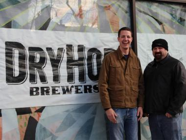 Greg Shuff and Brant Dubovick pose in front of the DryHop Brewery storefront at 3155 N. Broadway St. on Dec. 5, 2012. DryHop will open in March but until then is debuting collaboration beers across the city.