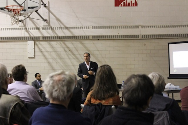 <p>JDL President James Letchinger gives a presentation at Clarendon Park Field House Dec. 13 to discuss a $220 million mixed-use development proposed in Uptown.</p>