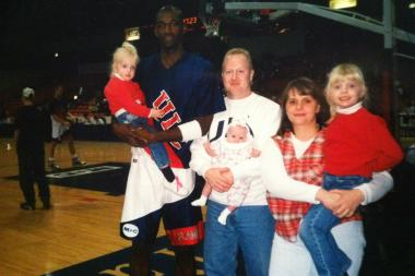 Longtime UIC season-ticket holder Jim Ryan holds his then-2-month-old daughter, Christina, while posing with (from left) daughter Sarah Ryan, 2; former UIC star Sherell Ford; daughter Jenna Ryan, 6; and Ryan's wife, Susan. The photo was taken at the UIC Pavilion in February 1995.