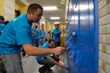 A partnership between Savos and Cesar Chavez Multicultural Center brought the downtown firm's workers to the school to paint the interior.