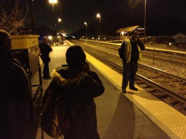 Commuters wait at the Rogers Park Metra station Wednesday.