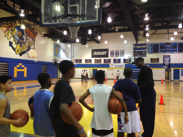<p>Ronnie Fields gives instructions to young players at the weekly workouts he hosts at Farragut.</p>