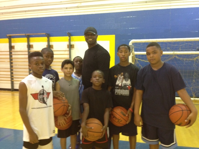 <p>Former Farragut Academy phenom Ronnie Fields is shown with young players during his weekly workout on Dec. 15.</p>