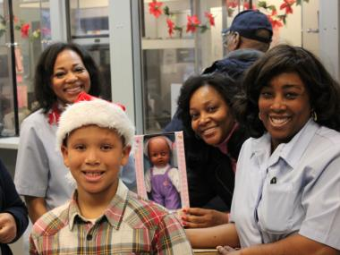 Samuel Love, 9, and U.S. Postal workers were all smiles Thursday after boxing up 593 toys he collected from a citywide toy drive. The toys were sent to the Salvation Army in New York where they will be distributed to kids affected by Hurricane Sandy.