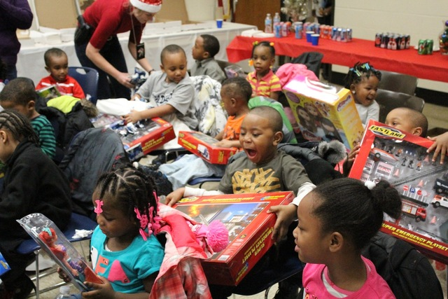 <p>Preschoolers from the Ada S. McKinley Trumbull Park Head Start program react to getting presents from their local police officers.</p>