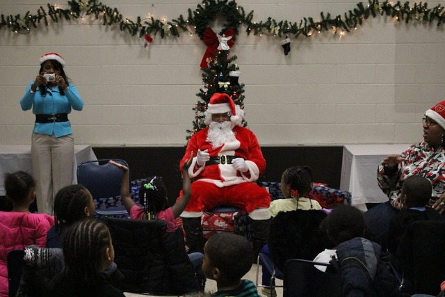 <p>Santa sings &quot;Santa Claus is Coming to Town&quot; with preschoolers from Ada S. McKinley Trumbull Park Head Start program.</p>