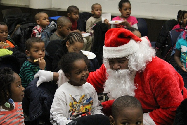<p>Santa listens to Christmas wishes of preschoolers from the Ada S. McKinley Trumbull Park Head Start program.</p>