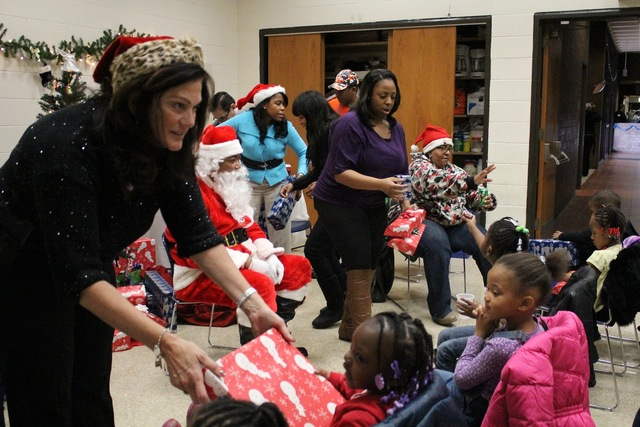 <p>Staff from the South Chicago District hand out presents to visiting preschoolers.</p>