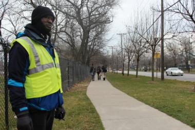 Slaughter Walker, 63, stands guard Thursday morning as part of a CPS effort to safeguard kids heading to the Gwendolyn Brooks College Preparatory Academy in Roseland. Students have been robbed repeatedly by a gang of teens in recent weeks.