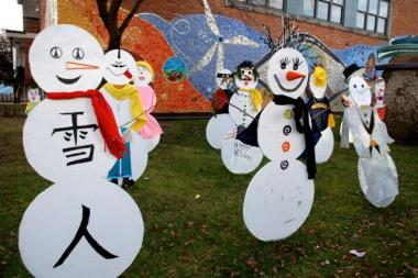 Snowmen on the lawn of LaSalle II Magnet School on the Division Street entrance to the school display a wide range of creativity.