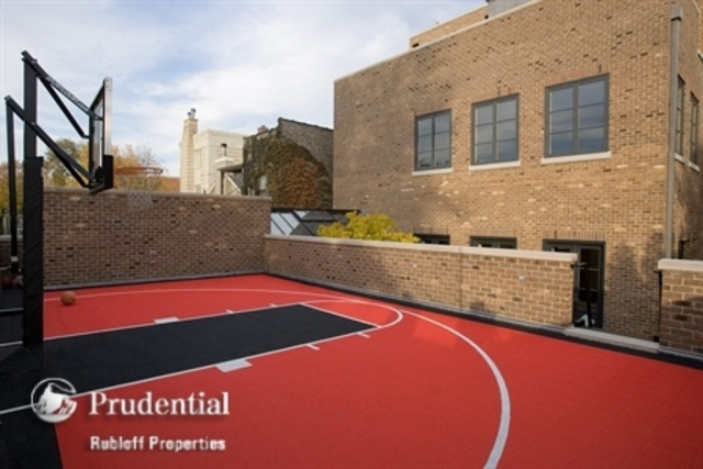 <p>The outdoor Sport Court sits on top of the four-car garage.</p>