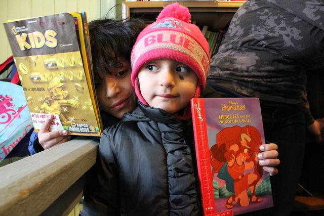 <p>Joaquin, 9, and his sister Carla, 3. Both read books from The People&rsquo;s Library, a library started by Rachel Perveiler on the back porch of her Little Village apartment.</p>