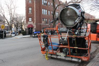 "A large spotlight on a cherry picker is parked on Sacramento Avenue for filming of a ""Chicago Fire"" episode, Tuesday, Jan. 8, 2013."