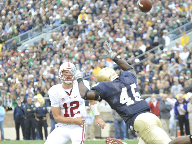 <p>Notre Dame outside linebacker Darius Fleming defends against Stanford quarterback Andrew Luck. Both players are now in the NFL.</p>