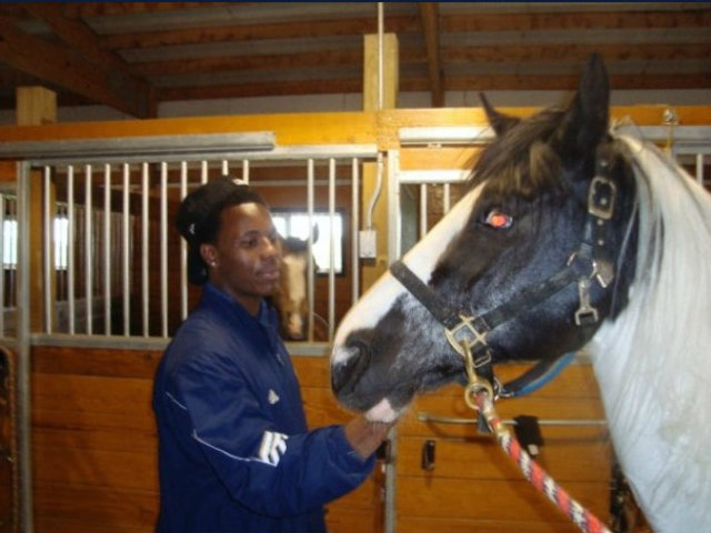 <p>Darius Fleming handles his horse, Stormy, a black and white paint quarter horse. Stormy died in March at age 17. Fleming, a St. Rita graduate, has been riding horses since he was 5 years old.</p>
