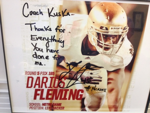 <p>An autographed Notre Dame photo of Darius Fleming rests in the office of St. Rita football head coach Todd Kuska.</p>