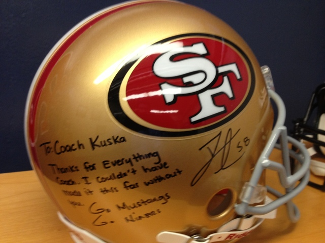 <p>An autographed San Francisco 49ers helmet of Darius Fleming rests in the office of St. Rita football head coach Todd Kuska.</p>