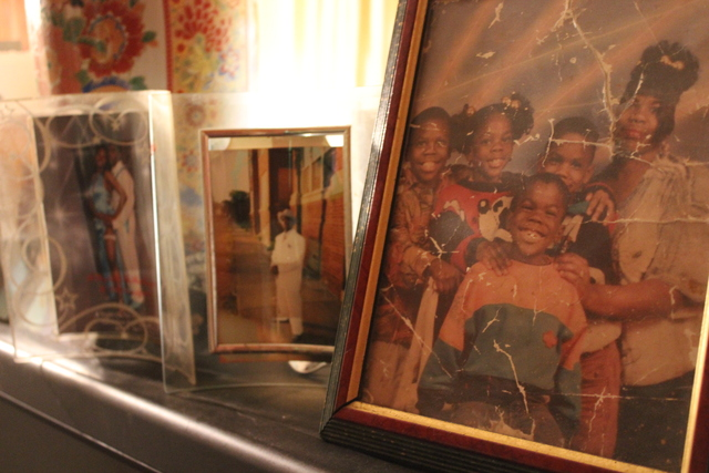 <p>Pictures of Kimberly Common&#39;s children rest on top of the television inside her home. Two of her sons, Devin and Antonio, were murdered in less than two years.</p>