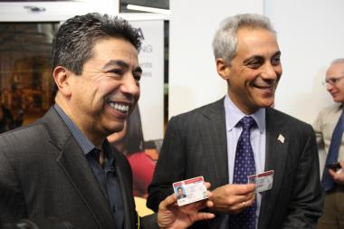 Mayor Rahm Emanuel and Ald. Danny Solis posed with their drivers licenses after the Illinois House passed a bill in support of drivers licenses for undocumented immigrants Tuesday.