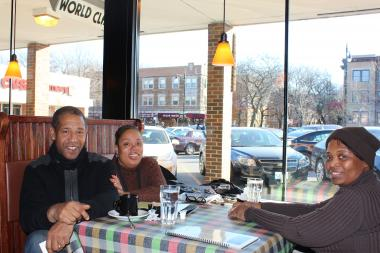 Marvin Mullen (from left), his wife Marilyn, and their friend Arnetha Gholston, enjoy their window view table during lunch Monday at Leona's restaurant in Hyde Park.