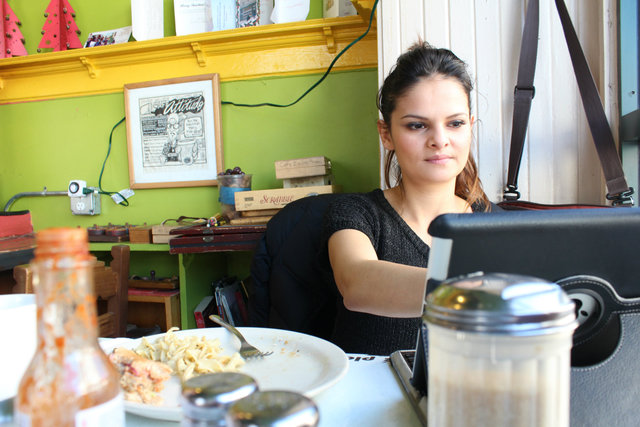 <p>Esmirna Garcia, 29, has been coming to the cafe regularly since her freshman year of high school. Cafe Jumping Bean just recently celebrated its 19th anniversary.</p>