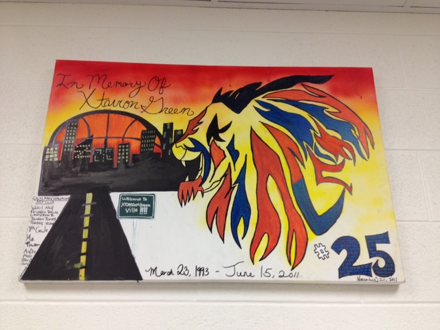 <p>A painting memorializes former CICS-Ellison student Estavion Green, who was fatally shot in 2011. Note: Estavion&#39;s name is spelled wrong in the painting.</p>