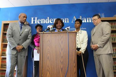 A federal lawsuit from the office of lawyer Sam Adam Jr. and the mother of an unarmed man fatally shot by Chicago police lists officers by name and claims racial slurs were used to taunt the crowd after her son was shot.