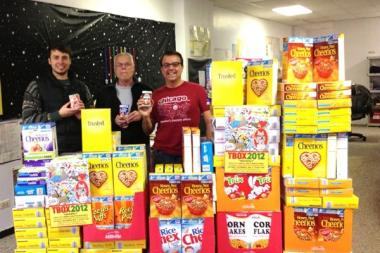Festa Parties, including owner Chris Festa (far r.), plans to hold monthly cereal fundraisers for Lakeview Pantry.