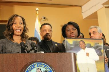Pamela Bosley talks about the pain of losing her son Terrell Bosley to gun violence in 2006 during a Thursday news conference at St. Sabina Church on the South Side, while a relative holds a photo of Terrell. The Rev. Jesse Jackson and Mayor Rahm Emanuel also called for stricter gun control at the press conference.