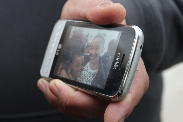 <p>Nathaniel Pendleton Sr. holds a photo of his two young kids. His daughter, Hadiya, was gunned down by an unknown assailant.</p>