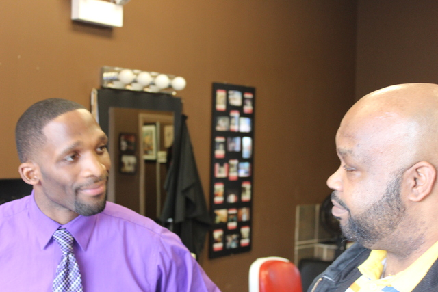 (from left) Julius McKinney, founder of Full Time Logistics LLC, talks to Dan Hayes, 42, about enrolling in his company's truck driving school Monday, Jan. 28, 2013 at a South Side career expo.