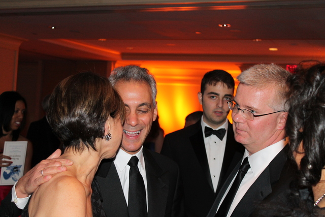 <p>Mayor Rahm Emanuel mingles at the Illinois Inaugural Ball in Washington, D.C., on Saturday.</p>